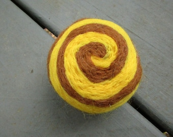 One multi-colored felted pin-cushion, Yellow and Brown