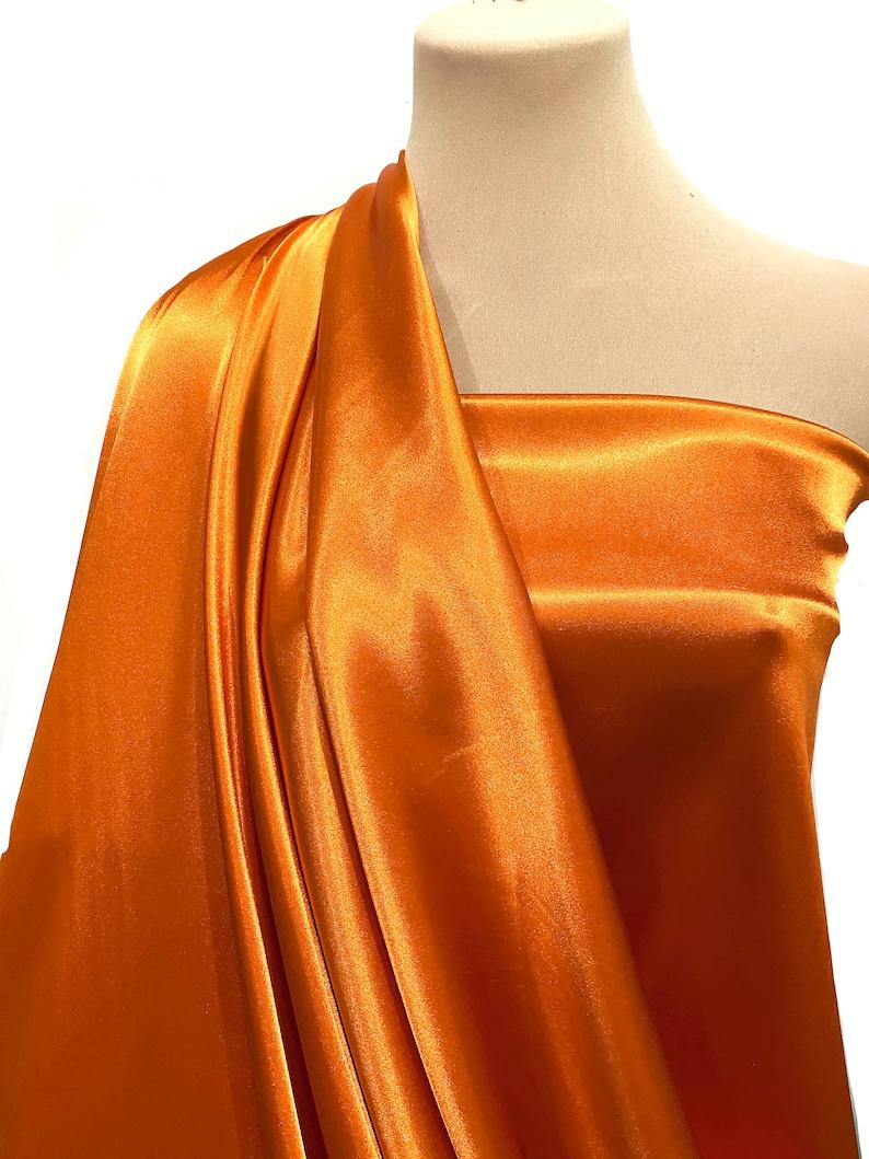 Stretch satin  Fabric Orange  by the yard.. image 0