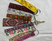 Fun little key chain, key fob, tribal floral bird jacquard ribbon zipper pull