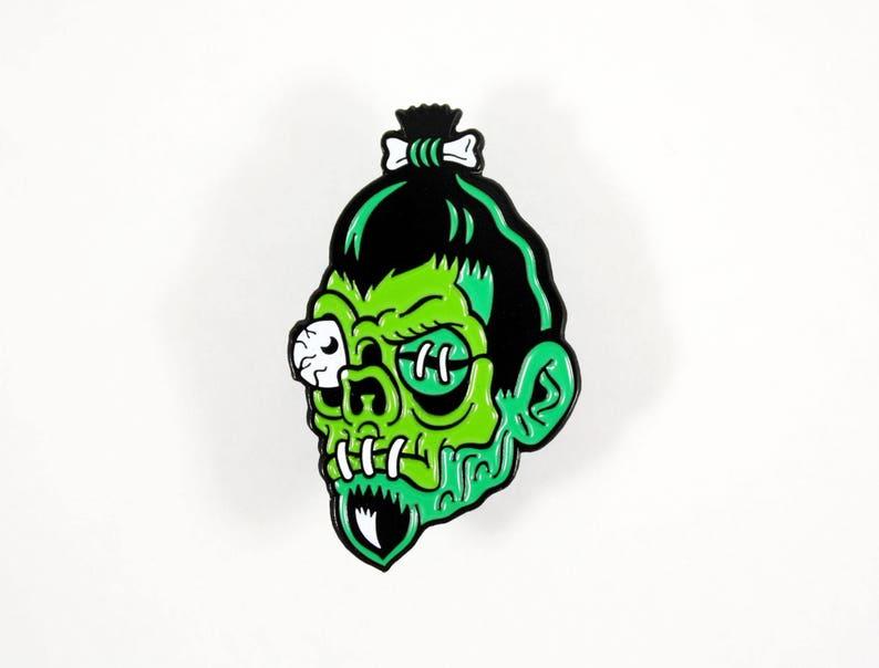 Shrunken Head Enamel Pin  1.5 Tiki Zombie Skull Lapel image 0