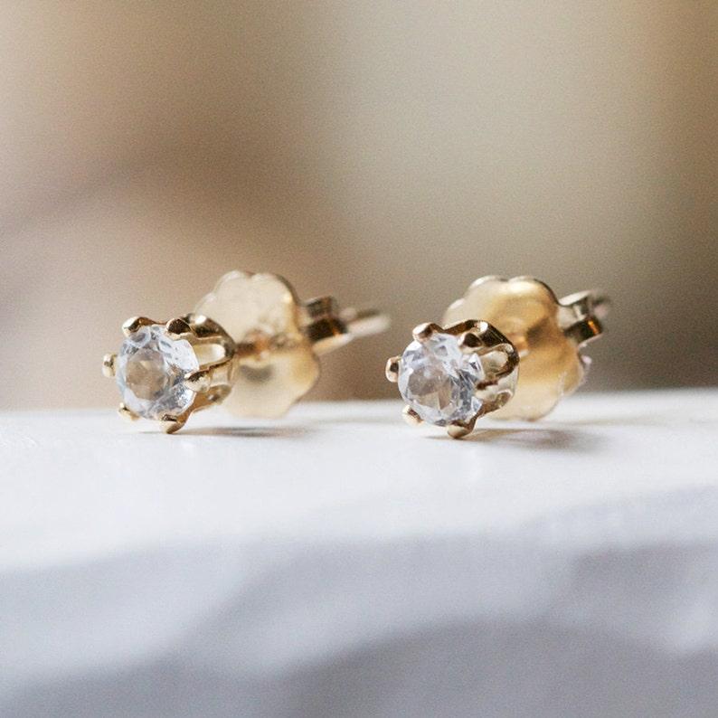 nova  tiny gold stud earrings by elephantine image 0