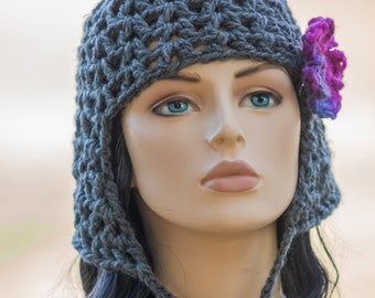 Cleo's New Hat - heather gray, crocheted beanie hat with ear flap, chin ties removeable pink flower hair clip. Cleopatra's wig bob hair cut.