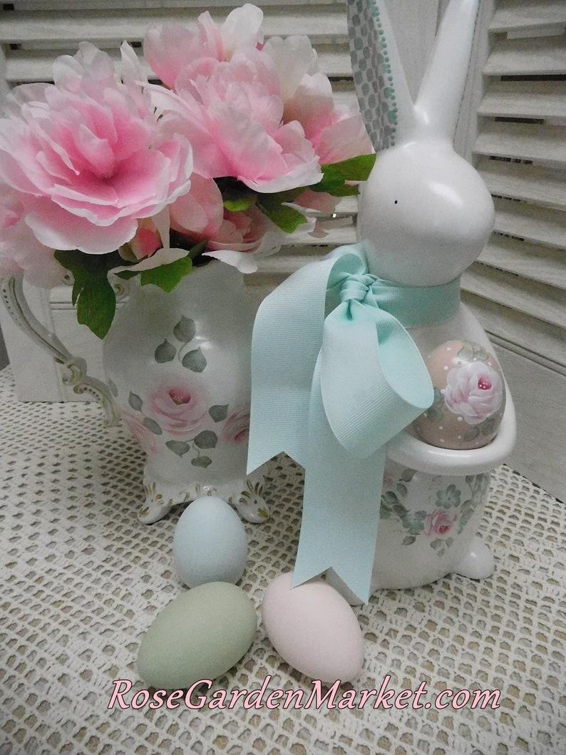 Tall Ceramic Bunny Holding Blush Rose Egg Hand Painted Vine image 0