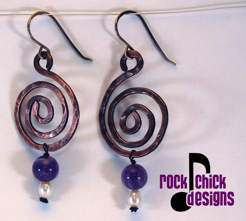 Spiral copper earrings medium 2 inch length with purple image 0