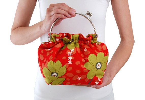 Red floral clutch purse with metal handle
