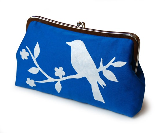 Royal blue clutch purse with screen printed bird in white