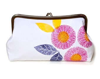 Handmade and hand-stamped clutch purse with magenta and yellow flowers on white