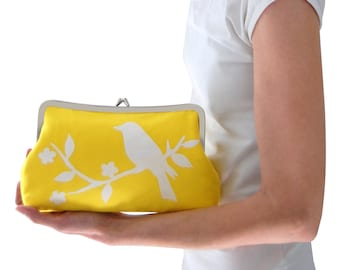 Yellow screen printed clutch purse with white bird