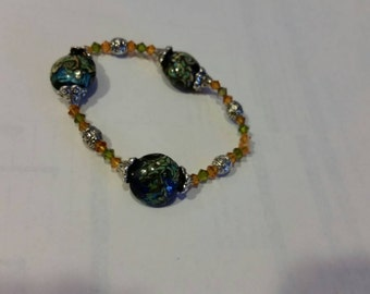 Swarovski crystals and Lentil Lampwork Beads with Tibetan Silver accents