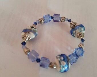 Elegant, Trendy, Modern, Swarovski Crystal,  Lentil Lampwork and silver Bali Beads Stretch Bracelet