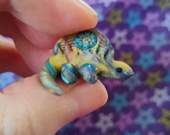 Tiny blue & gold swirl miniature cute kawaii dimetrodon sail back figurine OOAK dinosaur