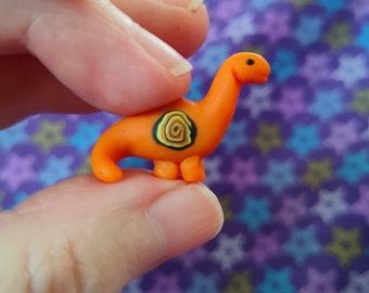 Tiny orange miniature cute kawaii brontosaurus figurine OOAK dinosaur