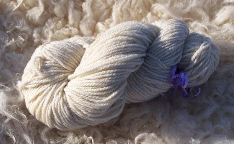 Creamy white merino yarn                                                       4 ounces