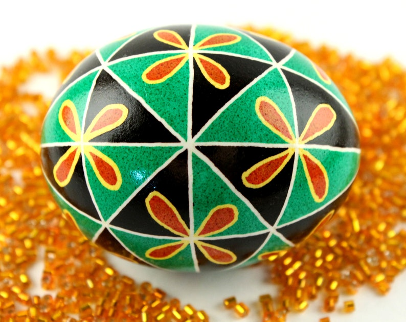 Green and Black Triangles with Orange Flowers Chicken Egg image 0