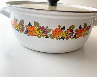 Vintage large enamel Dutch oven cooking pot, green with retro floral design.