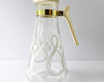 Vintage EZ Por Corporation juice pitcher carafe with lid and white scroll damask pattern.