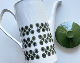 Vintage mod 1960s teapot, made in England. Green and white retro mod floral flower design.