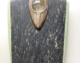 Vintage midcentury bathroom scale by the Borg-Erickson Corp, made in USA. Min green and marbled black.