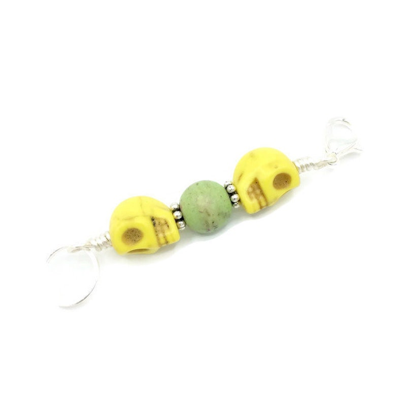 skull stitch markers for knitting and crochet yellow image 0