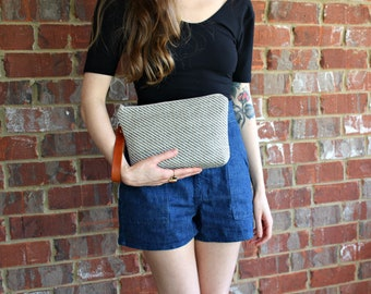 Genuine Leather Strap with upholstery fabric Wristlet / Clutch