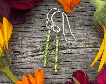 """August birthstone earrings with faceted peridot and sterling silver. Simple 1"""" gemstone drop earrings for Leo or Virgo birthday gift."""