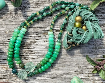 Green gemstone beaded necklaces with chrysoprase, fluorite, moss agate and peridot. Layering necklaces w/ adjustable length silk neckline.