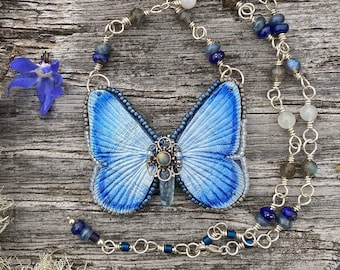 Silvery blue butterfly necklace with sterling silver and semiprecious stones. Boho style mixed media leather and gemstone jewelry.
