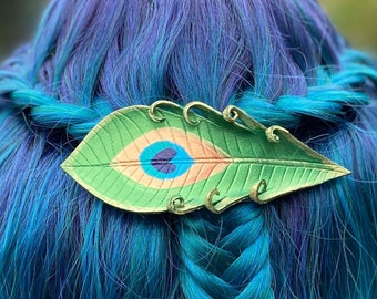 Hand painted peacock feather leather hair accessory. Jewel toned emerald green bird feather hair accessory with metal French clip barrette.