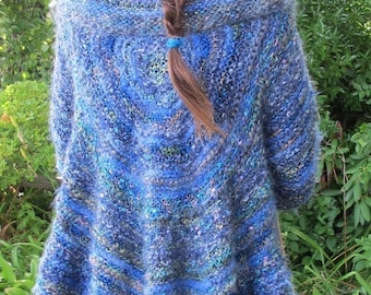 Circle Swing Coat, knitted with a variety of yarns, this circle has knit in sleeves to create a coat or shrug.   PDF knitting pattern