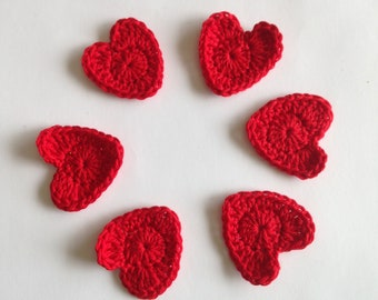 Crochet red heart appliqué in red.