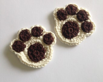 Paw print crochet appliqué in off white and brown