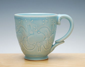 Hopping Bunnies mug in Frost