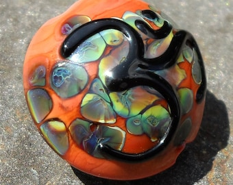 Sacred Om-handmade lampwork bead  large focal with  Om in fire coral and rainbow raku