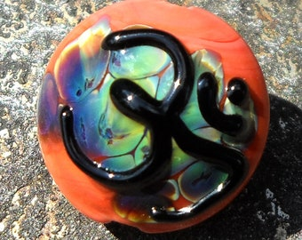 Sacred Om-handmade lampwork bead  small focal with  Om in fire coral and rainbow raku