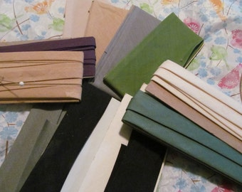 11 packages of vintage cotton seam binding, wide and narrow,various colors, '60s