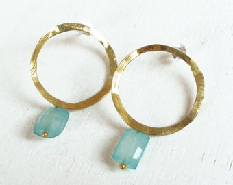 Gold hoop earrings with blue stone, irregular rustic brass circle, natural chalcedony stone, handmade in Spain, iomiss, stone jewelry