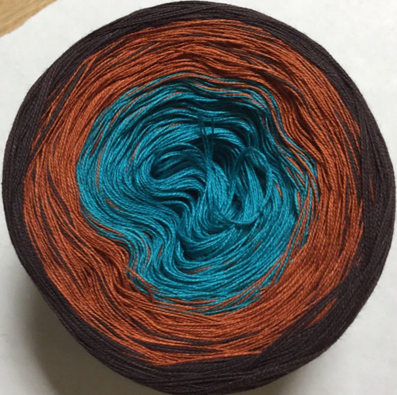 GT Weather Related 3-ply tied cotton gradient yarn as seen in image 0