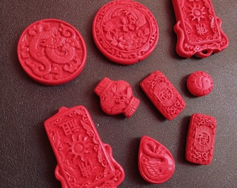 9 piece Cinnabar pendants various shapes and sizes