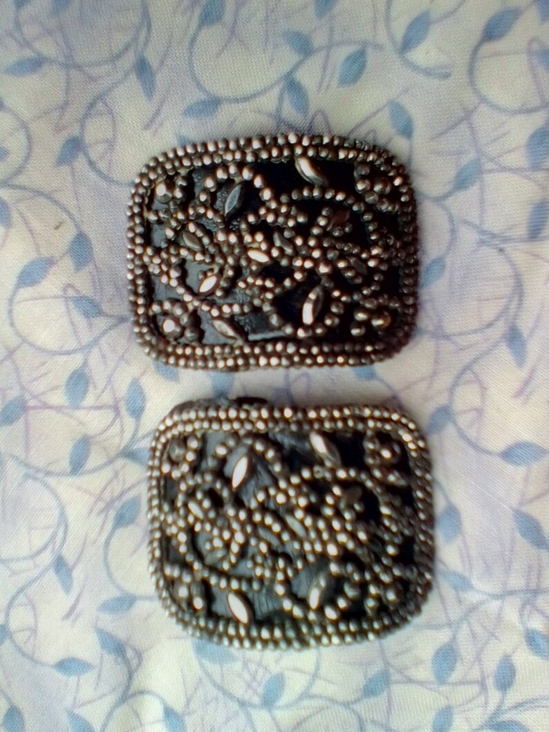 Cut steel shoe buckles 12 facets leather backed 17th-18th century