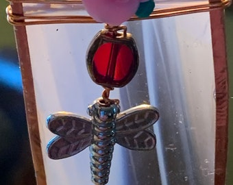 Pinkish glass with red beads