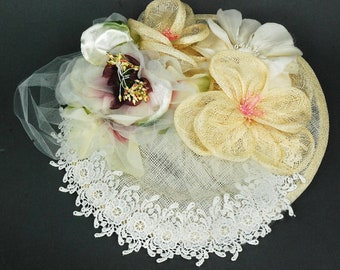 Ivory lace and flowers wedding hat/fascinator