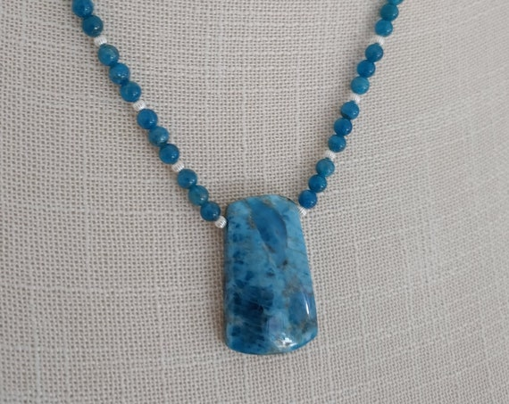 Blue apatite and sterling link chain.    Blue apatite is connected to the throat Chakra
