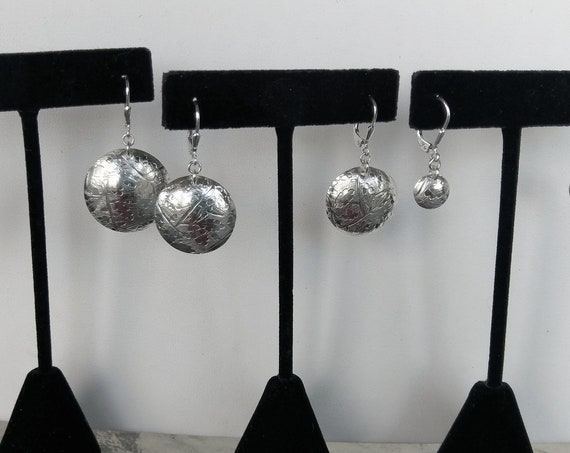 Sterling disc dangle earrings on leverback wires.  Three sizes, three prices.