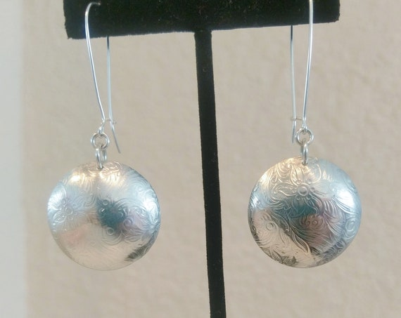 "Sterling textured discs on kidney wire earrings.  Stunning 2 1/2"" total drop 1""wide discs."