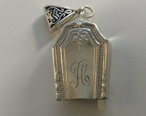 A monogrammed upcycled knife handle bell necklace!  Original monogram!   No extra engraving done.