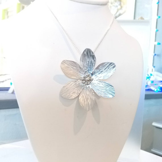 "Sterling silver Daisy flower with sterling balls and bail.  All hand fabricated on 18"" sterling silver chain. Very lightweight."