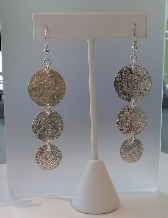 Three textured Sterling discs dangle on french wires.  Three sizes of discs.