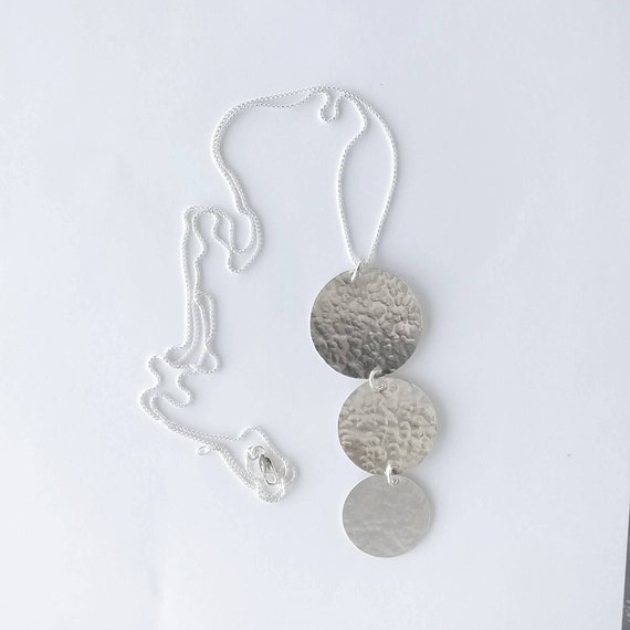 Simplicity! 3 Disc Hammered Silver pendant. Hangs from fully adjustable chain using a movable silicone lined bead that slides on chain.