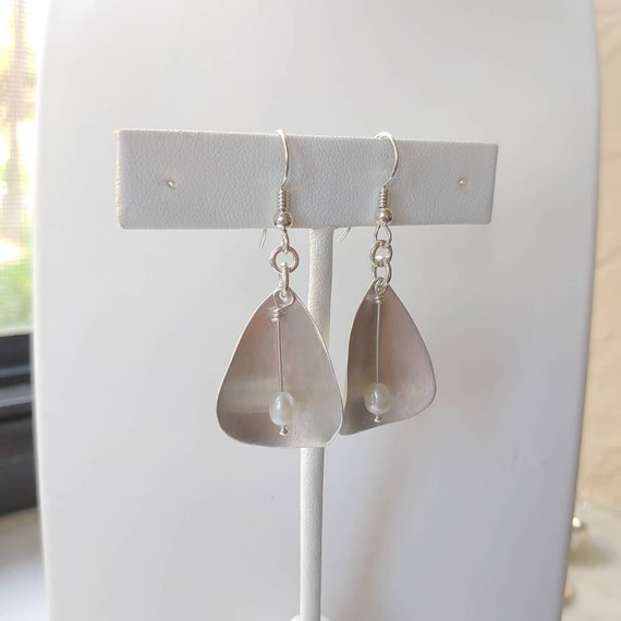 Open sterling silver Calla Lilies with freshwater pearl dangle earrings on French wires.