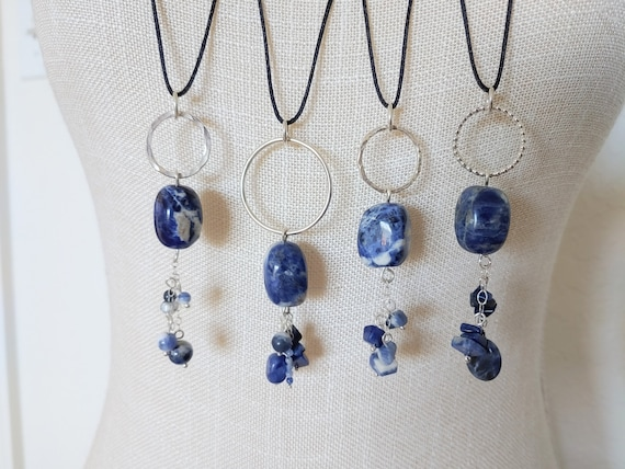 "Sodalite Nugget on sterling silver circle on satin cording with sodalite bead charms on sterling. 30"" length."